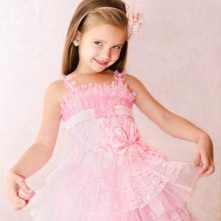 Portrait of cute smiling little girl in princess dress